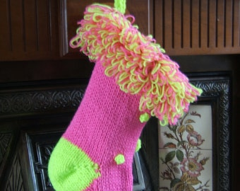 Pink Christmas stocking with looped pink and neon yellow top and neon yellow bobbles