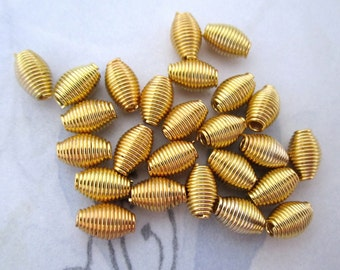 25 pcs. gold tone plated steel spring wire coil beads 9x6mm - f4877