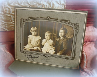 vintage cabinet card portfolio two kids and a baby cUte kids sepia tone studio portrait in fancy paper mat frame