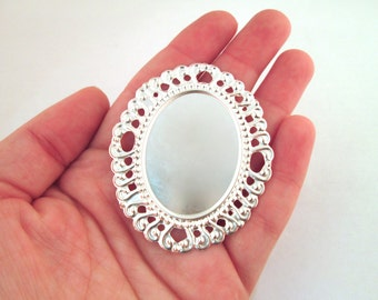Silver plated bezel filigree settings, holds a 30x40mm cabochon