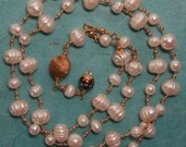 """Hand knotted creamy fresh water pearls, Czech glass, """"found"""" gold textured bead, 14kgold filled beaded necklace."""