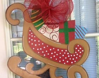 Christmas sleigh door hanger designed by Shirley's treasures.  In stock!