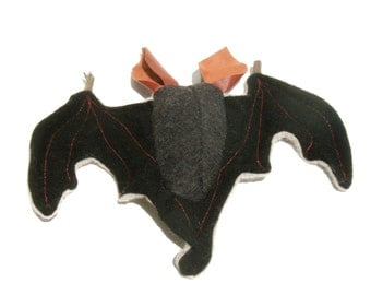A Red Eared Wool and Leather Bat