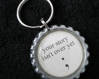 ONE 'Your Story Isn't Over Yet' Bottle Cap Charm Keychain
