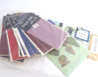 Scrapbooking supplies - embellishments, decorative paper accents, colorful paper trims, packaged wording