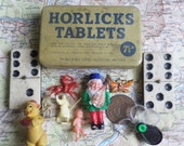 Vintage Horlicks Tablets Tin Box with found objects,gumball,cracker charms,tiny doll & gnome