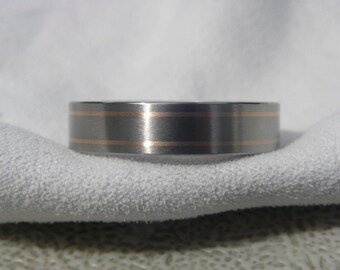 Titanium Ring with Two Narrow Pinstriped Rose Gold Inlays
