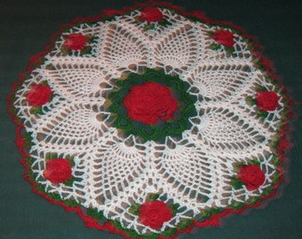 "Crochet Doily, 14"", Roses in center and edges, a ring of pineapples"