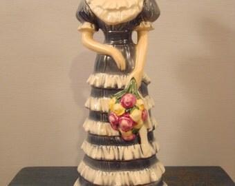 Beautiful Goebel figurine- woman with flower basket- series 4 of 4 1988
