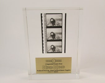 Vintage King Kong Paperweight 60th Anniversary Film Frames 35 MM Negative Three Sequential Frames of Movie Numbered 6634 Lucite Paperweight