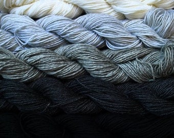 800 yards of pure wool yarn in sport weight, off white, black and grays,  5 skeins, 8.5 oz.