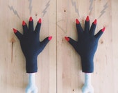Severed Hand with Red Nails