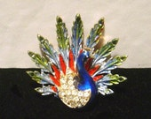 Vintage signed ART peacock Pin lovely colors