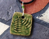 Dark Green Fern Stoneware Pendant on black satin cord