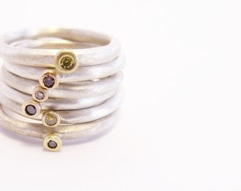 Wobble sterling silver rings with 18ct gold pebble set with a coloured Diamond.