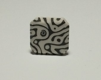 """Pocket fidget sgraffito carved porcelain worry stone in """"Map To Get Lost"""" design"""