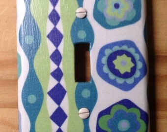 Geometric and floral switch plate cover