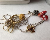 Golden Airplane ID Badge Lanyard with red charm accents and key hooks