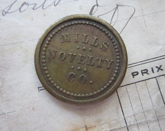 vintage token - Mills Novelty Co - coin token - good for 5 cents in trade