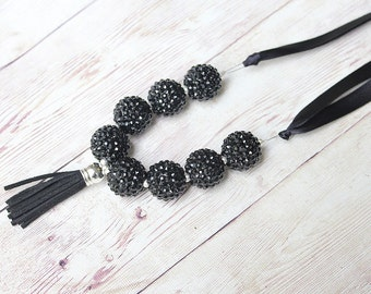 black metallic sparkle beaded  chunky necklace with tassle and ribbon