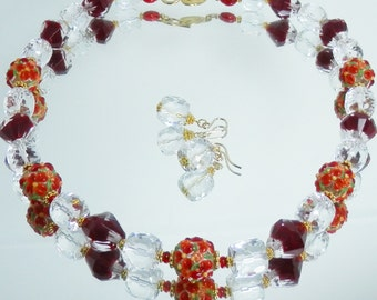 Shades of Red Necklace Set with Floral Beads, Crystal and Gold