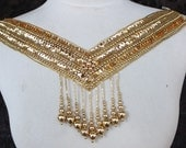 Cute  beaded and   embroidered  applique   gold color  1 pieces listing 14 inches wide at the neck 1 3/4 inches wide at the shoulder