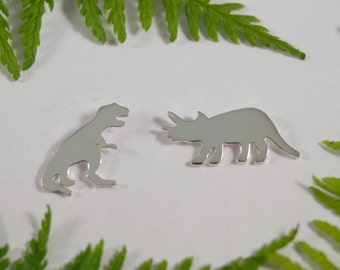 Silver Dinosaur earrings: A pair of Triceratops and T rex shaped sterling silver earrings.