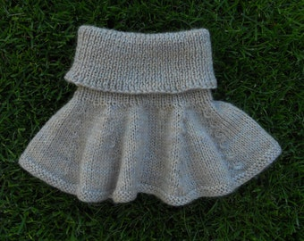 Skirt for a preemie/small baby, hand knitted in soft beige yarn