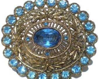 Vintage Rhinestone Jewelry Brooch Signed Little Nemo with Blue Glass on Pot Metal