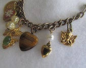 Angel Charm Bracket, tiger eye stone heart locket, faux pearl beads, gold finish metals, vintage chain