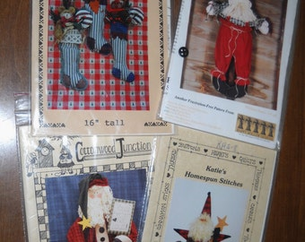 four Christmas country craft  patterns ... 3 santas ...stockings