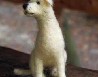 Needle felted dog sculpture.