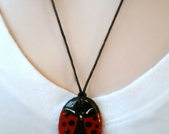 Rock out with reversible ladybug necklace - different hand painted ladybugs - large rock oval pendant - an American favorite cutie bug