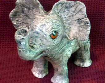 Elephant handmade in U.S. from a lump of clay, can be customized with words my best elephant yet!