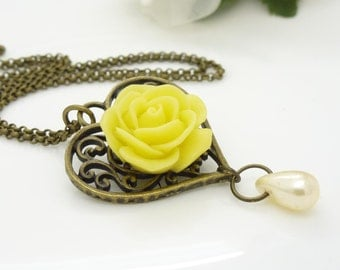 Cream pearl and yellow flower necklace, antique bronze filigree heart pendant, bright yellow necklace, resin flower jewelry