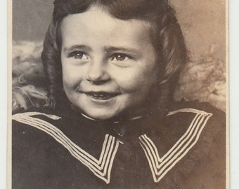 Vintage/Antique photo of an adorable little girl