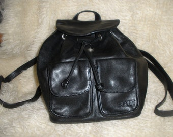 Black Espirit leather backpack, ladies bag, two front pockets, leather cord closure, side zips for easy access.