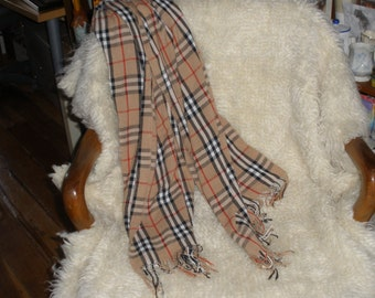 Camel, black and red plaid scarf ideal for fall and winter. Soft fabric in well recognized pattern. Excellent condition.