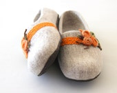 Women slippers handfelted from natural merino wool, decorated with orange linen laces and felted flowers