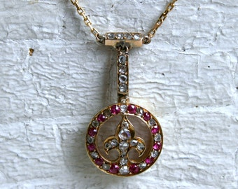 Beautiful Antique Ruby and Diamond Fleur De Lis Necklace in 18K Yellow Gold.