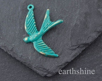 turquoise hand patinated brass swallow