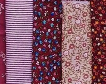 cotton fabric bundle of nos scraps--color coordinated cranberry, mauve, and pink calico prints--8 pieces