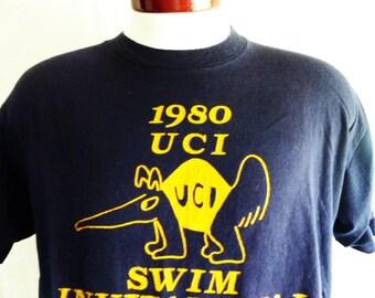 go UCI Anteaters vintage 80's University of California Irvine 1980 Swim Invitational mavy blue graphic t-shirt yellow gold mascot pint XL