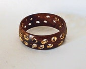 Wood bracelet with Golden Spaces