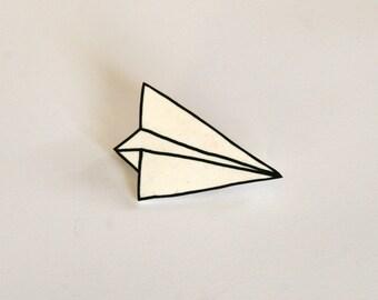White plastic paper plane brooch
