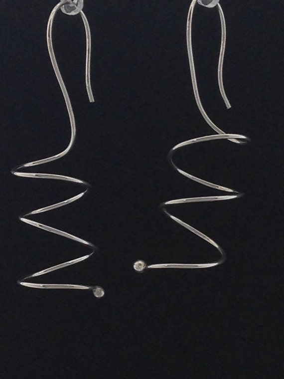 Argentium sterling silver spiral earrings with balled end.