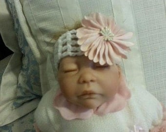 White headband with pink flower fits newborn