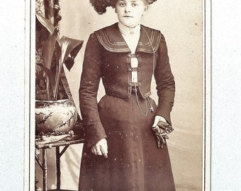 Carte-de-visite, antique, a young lady in a suit with an Ostrich feather trimmed hat. Charles Jones, Hull. c1900.