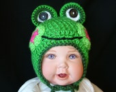 Green Baby Crochet Frog Hat  with large stand-up eyes.  Warm earflaps and ties under chin.