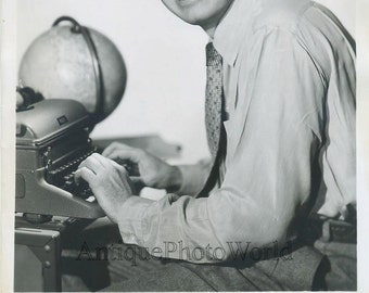Will Rogers Jr. with typewriter glove vintage photo